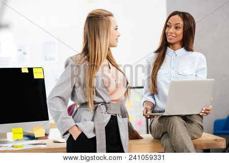 Portrait Of Smiling Multicultural Businesswomen In Office