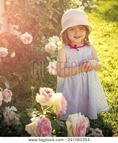 Future And Flourishing. Girl In Hat With Folded Hands In Summer Garden. Innocence, Purity And Youth