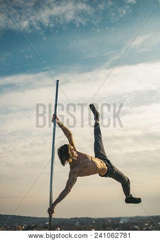Sexy Macho Man Fly On Blue Sky Background. Sexy Macho On Pole On Blue Sky Background