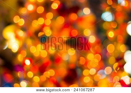 Blur - Bokeh Decorative Outdoor String Lights Hanging On Tree In The Garden At Night Time - Decorati