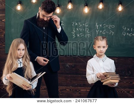 Pupil Is Having One-on-one Time With His Instructor. Pupil Taking Tutoring Courses With Beautiful Bl