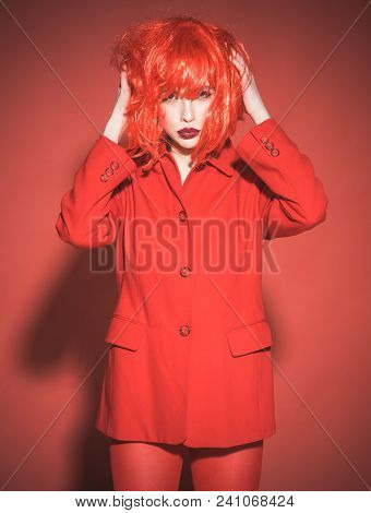 Portrait Of Beautiful Girl With Trendy Make-up Wearing Fancy Bob Style Wig. Totally Red Look, Young