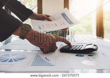 Analyst Concepts An Auditor Using A Calculator With A Budget Document Graph Chart To Monitor Company