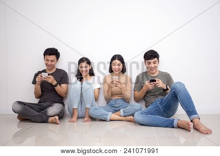 Asian People Using Smartphone With Happy Emotion. People With Technology Concept.