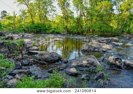 A Beautiful Rocky Landscape Of The Haw River In Springtime In North Carolina.