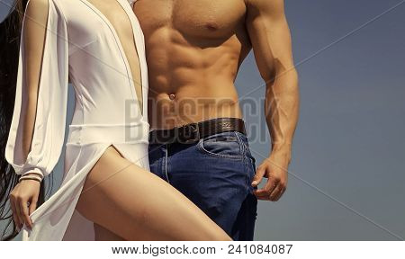 Mens Heals Care. Torso Of Male With Six Pack, Ab And Female In Sexy White Dress On Blue Sky. Strengt