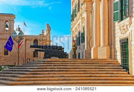 Valletta, Malta - April 1, 2014: Auberge De Castille Building And Cannon In Merchant Street In The O