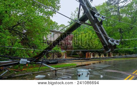 The Storm Caused Severe Damage To Electric Poles Power Lines Over A Road After Hurricanepoles Fallin