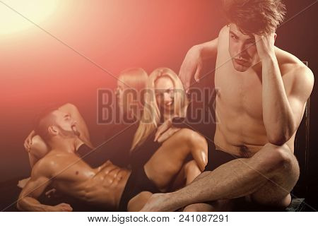 Attractive Friends Sitting On Black Background. Men With Muscular Body And Twins, Relations. Men And