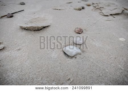 Stones On The Sand Are A Tranquil Scene