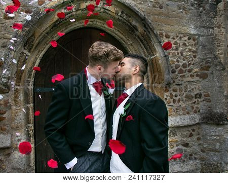 Gay Weddings Newly Wed Men, Dressed In Matching Morning Suits Leave Village Church With Smiles And A