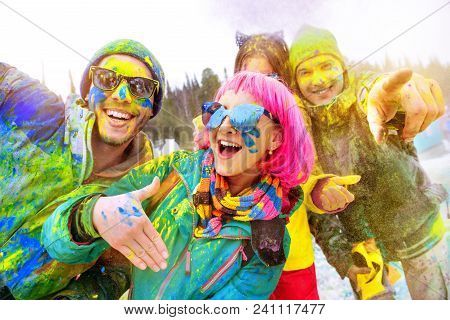 Group Of Happy Friends In Colorful Clothes Is Having Fun At Holi Color Festival