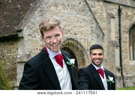 Gay Weddings Newly Wed Men, Dressed In Matching Morning Suits Leave Village Church. There Wearing Mo