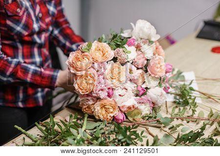 Female Florist. Floral Workshop - Woman Making A Beautiful Flower Composition A Bouquet.