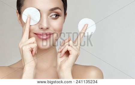 Beautiful Young Smiling Woman With Clean  Cotton Pads . Facial  Treatment   . Cosmetology , Beauty