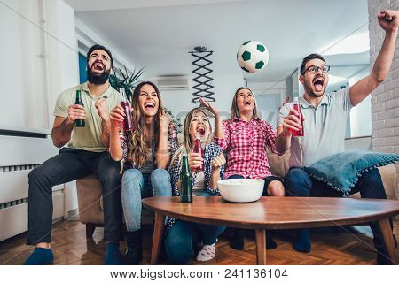 Happy Friends Or Football Fans Watching Soccer On Tv And Celebrating Victory At Home.friendship, Spo