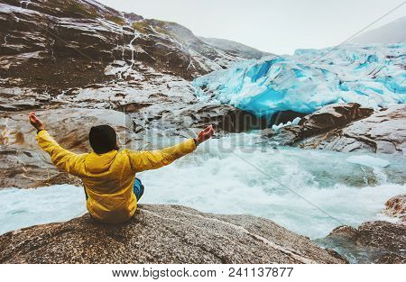 Man Traveler Meditating Yoga Outdoor Healthy Lifestyle Adventure Vacations  Mountains Glacier And Ri