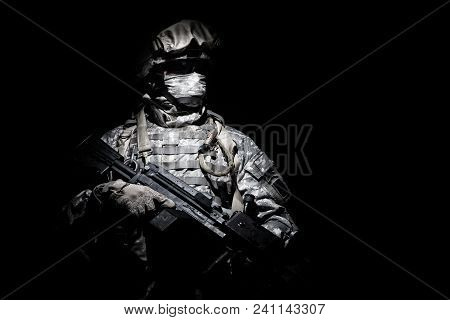 United States Armed Forces Soldier In Battledress With Black Glasses And Mask On Face, Armed Squad A