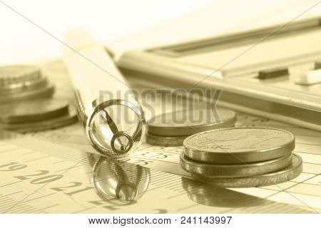 Financial Background With Money, Calculator, Ruler, Table And Pen, Toned.