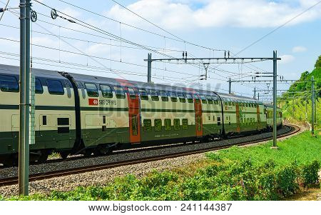 Lavaux, Switzerland - August 30, 2016: Running Train On The Railroad On Lavaux Vineyard Terraces Hik