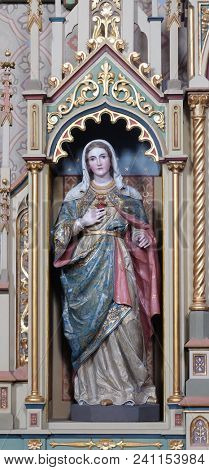STITAR, CROATIA - JUNE 24: Immaculate heart of Mary statue on the Sacred heart of Jesus altar in the church of Saint Matthew in Stitar, Croatia on June 24, 2017.