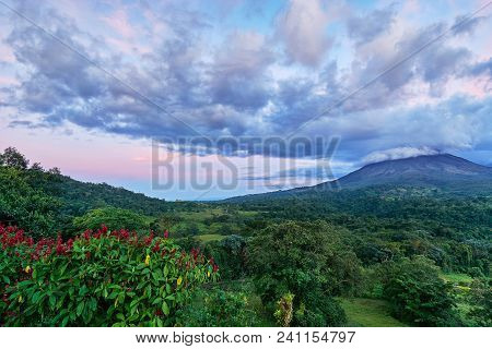 Evening At A Viewpoint In Costa Rica At Arenal National Park. Powerful Colored Clouds Due To Sunset