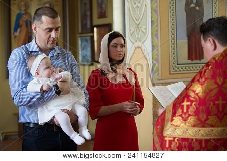 Belarus, Gomel, April 29, 2018. Church Of Volotovo. Baptism Of The Child.a Child At The Rite Of Bapt