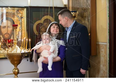 Belarus, Gomel, April 29, 2018. Church Of Volotovo. Baptism Of The Child.parents With The Baby In Th