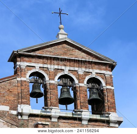 Red Brick Bell Tower With Three Metal Bells In Venice