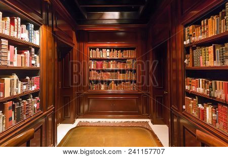 Brussels, Belgium - Apr 2: Bookshelves With Old Volumes Of Books And Antiquewooden Table Inside The