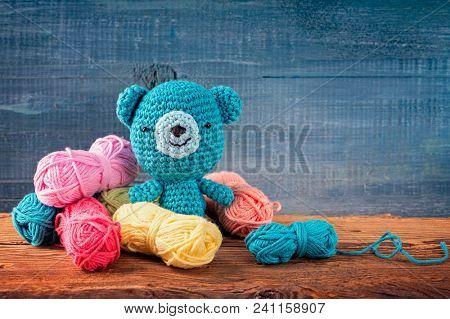 Amigurumi toys on a wooden background