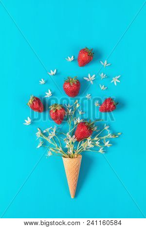 Cup Of Tea With Fresh Strawberries And Flowers Ornithogalum Blossom  Bouquets On Blue Surface. Flat