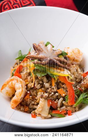 Fried Seafood Rice Served In A White Bowl