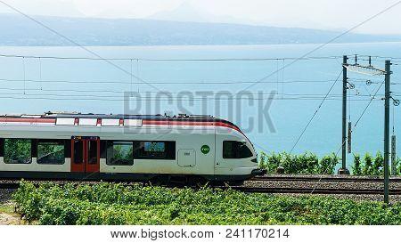 Bourg-en-lavaux, Switzerland - August 30, 2016: Running Train At The Railroad Near Lavaux Vineyard T