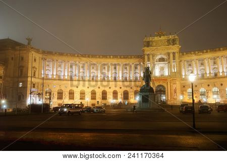 Vienna, Austria - January 8, 2014: Hofburg Palace In Vienna, Austria. At Mist And In The Night In Wi