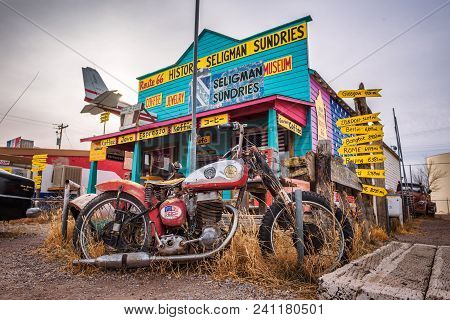 Seligman, Arizona, Usa - January 2, 2018 : Vintage Motorbike Left Abandoned In Front Of A Souvenir S