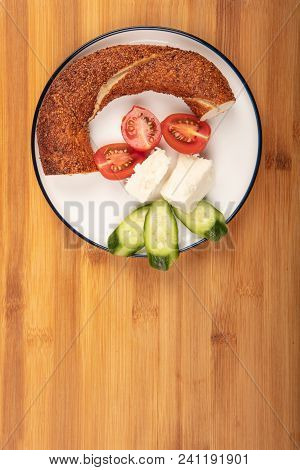 Breakfast With Feta Cheese,  Simit, Cucumber, And Cherry Tomoto  Isolated On Wooden Background Top V