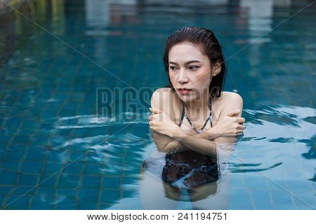 Young Woman Is Swimming In A Cold Plunge Pool