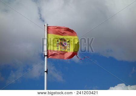 A Broken Spanish Flag In A Windy Day, A Non-urban Scene Day.