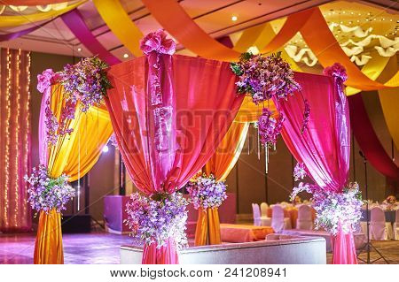 The Colorful Stage Decoration With Bright Shade Of Color For Bride And Groom In The Sangeet Night Of