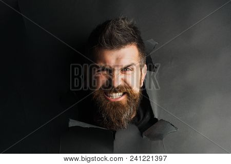 Angry Male Head Looking Through Paper Hole. Portrait Angry Man Peeping Through Black Paper Hole. Han
