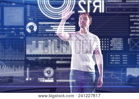 Working Day. Clever Qualified Software Developer Putting His Hand Up While Working With A Futuristic