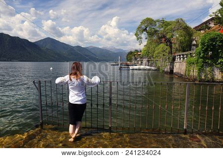 Young girl tourist in Orta San Giulio, famous resort on the western shore of Orta Lake, Italy, Europe
