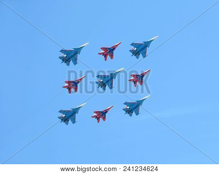 Moscow, Russia - May 9, 2018: Aerobatic Groups Russian Knights And Swifts On Mig-29 And Su-27 Fighte