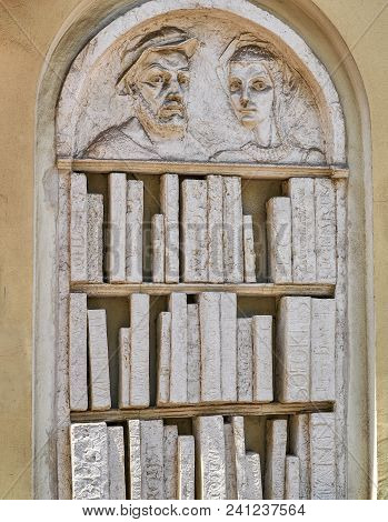 Relief Sculpture Of A Bookshelf With Books Made Out Of Stone Or Plaster