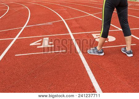 Athletic Woman Standing On Running Track