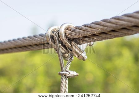 Macro Of A Silver Hook And Loop At A Fence Outside