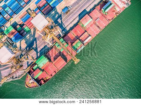 Top View Of Container Ship In Export And Import Business And Logistics. Shipping Cargo To Harbor By