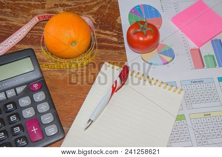 Concept Of Diet. Low-calorie Diet. Diet For Weight Loss. Measuring Tape, Citrus Fruit And Vegetarian