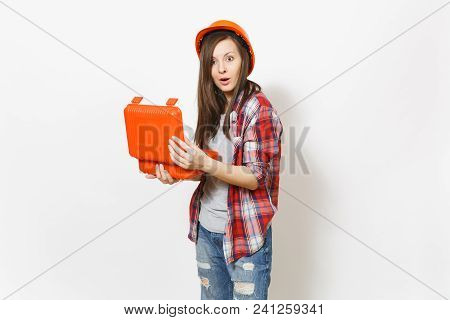 Young Shocked Woman In Casual Clothes And Protective Hardhat Holding Opened Case With Instruments Or